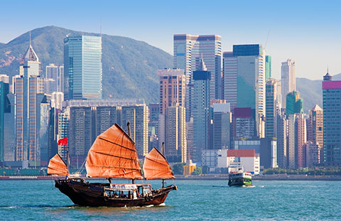 Hong Kong skyline with a sailboat in first plane